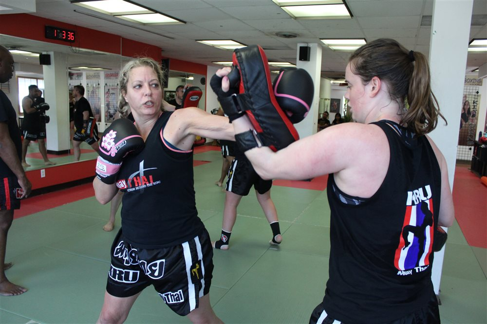 Essential Pad Holding Tips for Muay Thai and Martial Arts